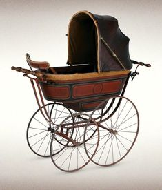 c. 1880s. An early wooden-bodied coach-built pram made by British pram manufacturer Silver Cross
