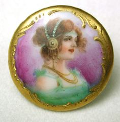 Antique porcelain button, hand ainted ady with fancy gilt border.