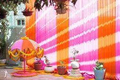 orange and pink mehendi theme , pink and orange umbrella , earthen pots…