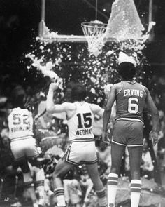 Dr J watches as Darryl Dawkins breaks the backboard