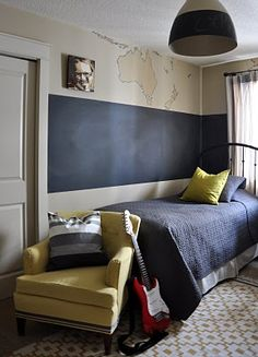 a thick band of chalkboard paint around this boys' room. i would have loved this when i was a kid.