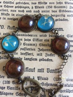 Armbänder - Armband türkis-bernsteinfarbend mit echten Blumen - ein Designerstück von Buntes-Treiben-Heinze bei DaWanda