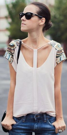 Cream blouse with cutouts and sequined shoulders. Awesome.
