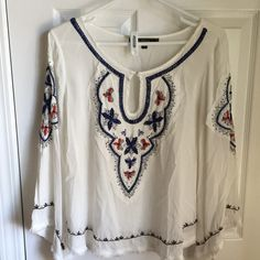 Summery peasant top Great shirt for summer! Peasant top featuring beautiful sown details. In perfect condition other than small pink stain on upper neck. Would look great with a pair of cutoffs or jeans and wedges for summer! Love Stitch Tops Blouses