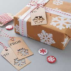 Google Image Result for http://assets0.notonthehighstreet.com/system/product_images/images/000/862/659/preview_recycled-snowflakes-christmas-gift-wrap-set.jpg%3F1354015162