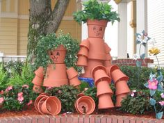 Flower Pot People - I've seen these made with clay pots, painted