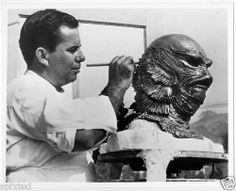 Bud Westmore, part of a family dynasty of makeup wizards, touching up a Gill Man headpiece ca. 1954.
