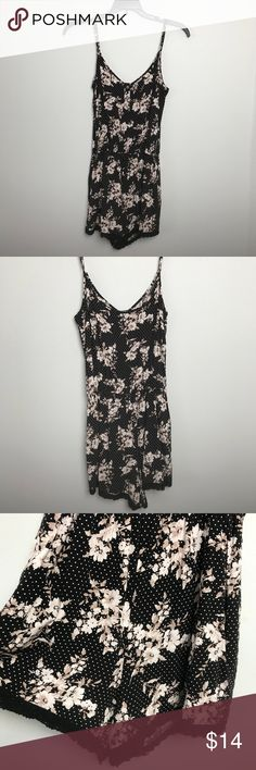 Forever 21 Romper. Size S Forever 21 Romper. Adjustable Spaghetti straps, elastic waist. Lacey hemline. Black with white & tan floral pattern. Size S Forever 21 Pants Jumpsuits & Rompers