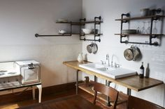 Plumbers' piping and reclaimed timber shelves. Link to tutorial. Hudson Milliner Kitchen Remodelista