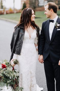 Leather and Lace. Anne Barge Bride Erin paired a leather bomber jacket with her lace wedding dress for a modern romantic touch.