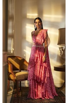 Fuchsia print hand embroidered blouse paired with a layered pre-stitched saree in georgette and highlighted belt with tassel detailing Indian Wedding Outfits, Indian Outfits, Indian Clothes, Western Outfits, Indian Attire, Indian Ethnic Wear, Dress Indian Style, Indian Dresses, Ethnic Fashion