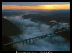 New River Gorge, West Virginia. Saw this on our whie water rafting trip. West Virginia Bridge, Fog Images, New River Gorge, Harpers Ferry, Scenery Pictures, Whitewater Rafting, Places To Go, Beautiful Places, Country Roads