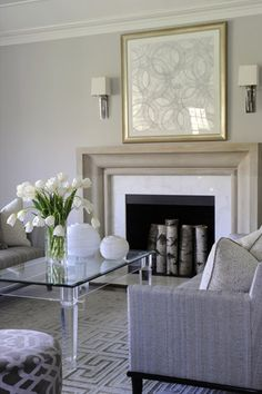 Cobble Court. Coffee table, beautiful fireplace and lovely carpet.