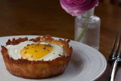 Eggs Baked in a Crunchy Potato Crust with Parmesan-Onion Cream. Perfect for Mother's Day breakfast!