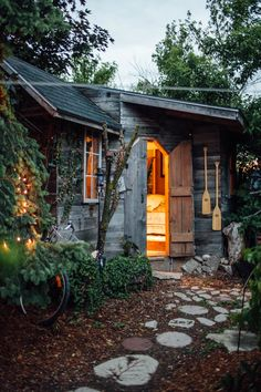 THE BUNKIE | Omis Haus B&B About 30 minutes outside of Niagara Falls in St. Catherines, Ontario is a tiny cabin featuring a wisteria and fairy-lined backyard complete with hot tub and swimming pool.