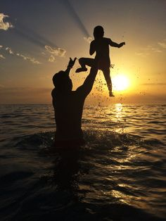 A father play in the water with his son at sunset Dips, Joy, Celestial, Sunset, Water, Photography, Outdoor, Portraits, Water Water
