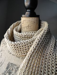 The Rustic Ribbed Mesh Scarf was knitted using a simple stitch pattern called the ribbed mesh stitch. It has a rugged southwestern feel with the lateral braid as its borders.