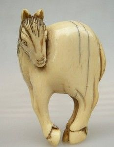 Netsuke, Ivory, Grazing Horse, unsigned, 18th c.