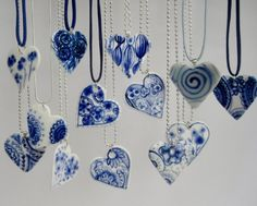 This is the work ofHarriet Damave who makesunique hand painted Porcelain Delft blue Jewelry