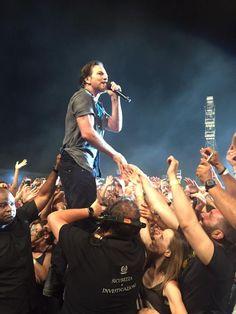 Eddie Vedder Holding the mic Singing At Firenze rocks June 24, 2017