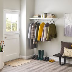 You don't need a big foyer or even a closet to create a place for jackets and shoes. A simple shelf-and-rod combination will do the trick. Wood Shelves, Shelving, Foyer, Entryway, Hanging Organizer, Real Wood, Mudroom, Home Organization, Make Your Own