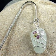 Diy how to wrap sea glass with wire.  Can do so many things with it.  I need some sea glass.