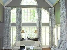 custom window treatments for two story windows Find more purchasing options at www.creativewindows.com