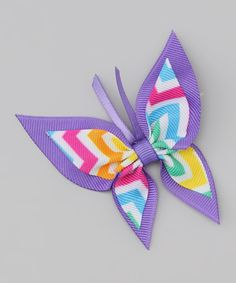 Neon hues and a vibrant pattern make this colorful flair for hair. The butterfly shape is sure to set little hearts a-flutter.3'' W100% polyesterMade in the USA