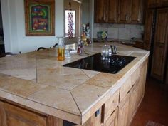 I like tiled countertops....especially like the use of thes larger ...