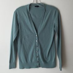 Ann Taylor cardigan Gently used cardigan from Ann Taylor in a beautiful sea foam/ light teal green color. Beautiful gold detail on the buttons. Some light pilling under the arms, priced accordingly. 60% cotton 40% viscose Ann Taylor Sweaters Cardigans