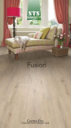 Fusion Luxury Vinyl Tile. The pale grey and blond tones, and subtle wood grain typical of this species has been beautifully replicated in Country Elm. the extra wide plank format and bevelled edging along on all four sides creates a sophisticated look that enhances any interior. The product has been simply straight laid in this installation