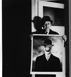 Portrait of painter Magritte with his painting.  Bill Brandt.