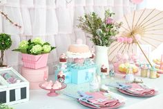 An Easter Brunch that uses pink and blue in the design set with dress up accessories for the kids! Tea party sandwiches and chocolate eggs on topiary's!
