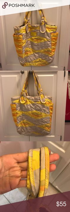 Marc Jacobs nylon purse Yellow, orange and grey purse. Handles are dirty with stain on front (as seen in photos). Otherwise, fine-good condition. Marc By Marc Jacobs Bags Shoulder Bags