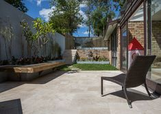 Cinnamon Travertine pavers are the most practical colour - with minimal cavities to help hide dirt, Agreat stone paving option for use in courtyards, patios or fashionable-covered outdoor rooms. #outdoorpavers #naturalstone