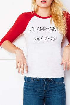 Super soft Baseball Style tee in red and white features an all time favorite toast of Champagne and Fries. The fit is unisex and runs true to size.     Champagne & Fries Tee by Bella Canvas. Clothing - Tops - Tees & Tanks Louisiana