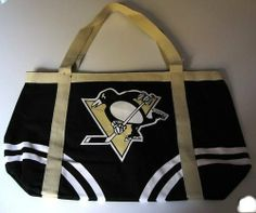 """NHL Pittsburgh Penguins Canvas Tailgate Tote by Pro-FAN-ity by Littlearth. $13.29. 14 oz Knit Cotton Canvas. Large Interior Zipper Pocket. Machine Washable. Features Over-Sized Team Logo. Officially Licensed. Littlearth's Officially Licensed Canvas Tailgate Tote is great at the beach, on day trips or a quick weekend bag! Measuring 15.5"""" Length x 6"""" Width x 13.5"""" Height this large heavy tote is the perfect bag for your tailgating party. Made of 100% Cotton this 1..."""