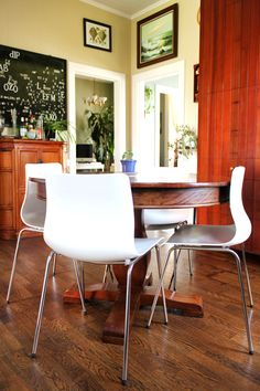 use traditional round table with modern white chairs
