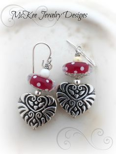 Red, white polka dot lampwork glass, white stone and silver heart engraved sterling silver earrings.