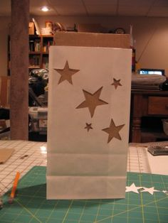 Instructions for Luminaries - she used a bag of sand and tea light candle inside