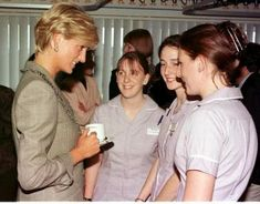 April 22, 1997:  Diana, Princes of Wales visits St. Mary's Hospital in London for the Cosmic Charity on Behalf of the Paediatric Intensive Care Unit.