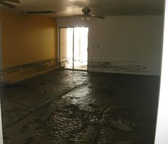 flooded muddy mess high water mark on walls damaged Wickenburg Arizona home house for sale photo