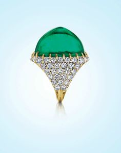 A 53.46 carats Colombian Emerald and Diamond Ring.