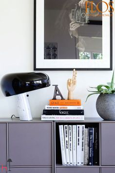 Snoopy is a table lamp designed by Achille and Pier Giacomo Castiglioni for Flos.