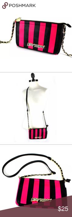 """Betsey Johnson Crossbody Chain Purse Bag Betsey Johnson Black Fuchsia Pink Stripe Crossbody Chain Purse Bag   Color: black, fuchsia pink Size: 5.5"""" H x 9"""" W x 1"""" D  Strap measurement is approximately 22.25"""", total height including straps is approximately 28.5""""  Feature a main zipper closure compartment and front flap style wallet compartment.  Condition: great, pre-owned No known issues (see all photos)  All photos are of the actual item that you will receive. There are no stock photos used…"""