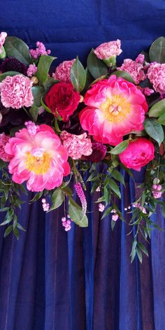 Photobooth backdrop made with fresh florals by BW Events @brookeward.events