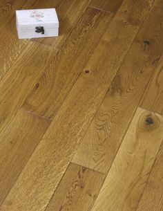 Golden oak was a very popular product for us in solids woods but as the trends have moved towards the more stable engineered floors we decided to change this product and make it in a high specification engineered board. It is made up of a 13mm layers of spruce which has to give strength and stability, which is then bonded to 5mm of European white oak.  The top layer of oak is brushed and stained to give a stunning golden brown oak finish.