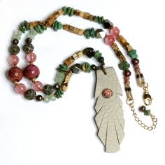 Leather Feather Necklace with Hand-Knotted Genuine Turquoise & Gold Filled Beads, Pink Quartz, Authentic Jewelry with a Bohemian Soul from MeyerClarkCreative. Etsy Jewelry, Jewelry Art, Jewelry Design, Gemstone Jewelry, Beaded Jewelry, Jewelry Necklaces, Jewellery, Quartz Rose, Pink Quartz