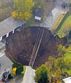 An aerial photo shows a massive crater that appeared in a residential street in Schmalkalden, Germany, in November 2010 An aerial photo sho...