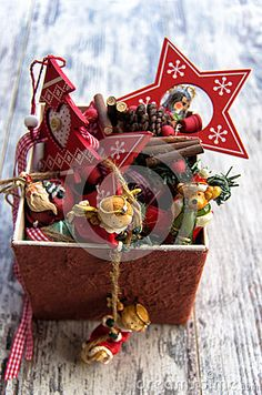 Christmas decorations in a box on wooden background